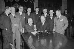 Delegates signing the agreement to bring Newfoundland into Confederation