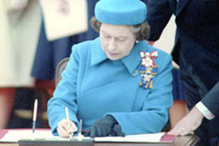 Queen Elizabeth II signing the Constitution