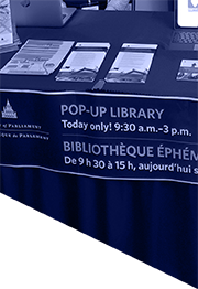 Pop-up library table with Library of Parliament products