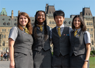 Tour guides standing in front of Centre Block